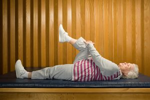 Woman lying down stretching